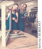 Купить «Foreman explaining plastic windows assembly process to young female worker», фото № 30803417, снято 19 июля 2017 г. (c) Яков Филимонов / Фотобанк Лори
