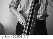 Купить «Man plays modern electric contrabass», фото № 30808117, снято 18 мая 2019 г. (c) EugeneSergeev / Фотобанк Лори
