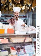 Купить «Seller showing piece of meat in butcher's store», фото № 30809081, снято 2 января 2017 г. (c) Яков Филимонов / Фотобанк Лори