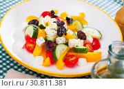 Купить «Greek vegetable salad with cheese and olive oil», фото № 30811381, снято 14 ноября 2019 г. (c) Яков Филимонов / Фотобанк Лори