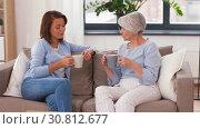 Купить «senior mother and daughter with coffee talking», видеоролик № 30812677, снято 12 мая 2019 г. (c) Syda Productions / Фотобанк Лори
