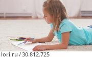 Купить «girl drawing with crayons in sketchbook at home», видеоролик № 30812725, снято 12 мая 2019 г. (c) Syda Productions / Фотобанк Лори