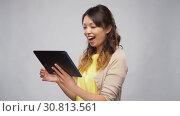 Купить «asian woman using tablet computer», видеоролик № 30813561, снято 17 мая 2019 г. (c) Syda Productions / Фотобанк Лори
