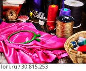 Купить «Seamstress group object red and gold sewing spool and embroidery hoop», фото № 30815253, снято 18 мая 2019 г. (c) Gennadiy Poznyakov / Фотобанк Лори