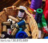 Купить «Sewing accessories coil threads and measuring tape in basket supplies», фото № 30815689, снято 19 мая 2019 г. (c) Gennadiy Poznyakov / Фотобанк Лори