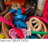 Купить «Sewing accessories coil threads and bias tape in basket supplies», фото № 30817613, снято 19 мая 2019 г. (c) Gennadiy Poznyakov / Фотобанк Лори