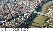 Купить «Aerial view of Zaragoza with Cathedral-Basilica of Our Lady of Pillar on bank of Ebro river, Spain», видеоролик № 30818237, снято 24 декабря 2018 г. (c) Яков Филимонов / Фотобанк Лори