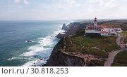 Купить «Scenic aerial view of lighthouse at cape Cabo da Roca in sunny spring day, Portugal», видеоролик № 30818253, снято 21 апреля 2019 г. (c) Яков Филимонов / Фотобанк Лори