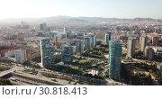 Купить «Panoramic aerial view of district of Barcelona with modern apartment buildings», видеоролик № 30818413, снято 5 марта 2019 г. (c) Яков Филимонов / Фотобанк Лори
