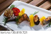 Купить «Tasty baked rainbow trout steaks with potatoes and greens on white plate», фото № 30819721, снято 20 июня 2019 г. (c) Яков Филимонов / Фотобанк Лори