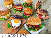 Купить «Assorted hamburgers», фото № 30819741, снято 22 июля 2019 г. (c) Яков Филимонов / Фотобанк Лори
