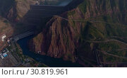 Купить «Город Нурек, плотина, водохранилище. Вид с дрона. Таджикистан», видеоролик № 30819961, снято 3 июня 2016 г. (c) kinocopter / Фотобанк Лори