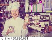 Купить «Woman selling chocolates and confectionery», фото № 30820681, снято 31 марта 2020 г. (c) Яков Филимонов / Фотобанк Лори