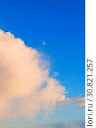 Купить «Sunset colorful sky background - pink dramatic colorful clouds lit by evening sunshine», фото № 30821257, снято 27 марта 2018 г. (c) Зезелина Марина / Фотобанк Лори