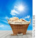 Купить «Laundry basket with clothes on rustic table against blue summer sky», фото № 30832945, снято 27 мая 2020 г. (c) easy Fotostock / Фотобанк Лори