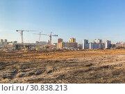 Купить «Construction of a residential microdistrict in city», фото № 30838213, снято 20 апреля 2019 г. (c) Дмитрий Тищенко / Фотобанк Лори