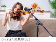 Купить «Female beautiful musician playing violin at home», фото № 30839053, снято 1 октября 2018 г. (c) Elnur / Фотобанк Лори