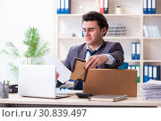 Купить «Young male employee being fired from his work», фото № 30839497, снято 18 февраля 2019 г. (c) Elnur / Фотобанк Лори