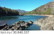 Купить «Low-altitude hedgehop flight on drone over stone rocky bank and river waters», видеоролик № 30840337, снято 11 мая 2019 г. (c) Serg Zastavkin / Фотобанк Лори