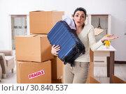 Купить «Young woman moving to new flat», фото № 30840537, снято 30 января 2019 г. (c) Elnur / Фотобанк Лори