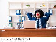 Купить «Young clown businessman working in the office», фото № 30840581, снято 14 декабря 2018 г. (c) Elnur / Фотобанк Лори