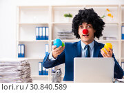 Купить «Young clown businessman working in the office», фото № 30840589, снято 14 декабря 2018 г. (c) Elnur / Фотобанк Лори
