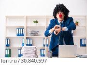Купить «Young clown businessman working in the office», фото № 30840597, снято 14 декабря 2018 г. (c) Elnur / Фотобанк Лори