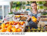 woman vendor at fruit department. Стоковое фото, фотограф Яков Филимонов / Фотобанк Лори
