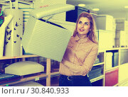 Купить «Young woman choosing soft pouf in modern home furnishings store», фото № 30840933, снято 15 января 2018 г. (c) Яков Филимонов / Фотобанк Лори