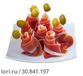 Купить «Rolled up dry-cured ham slices with olives», фото № 30841197, снято 17 июня 2019 г. (c) Яков Филимонов / Фотобанк Лори