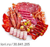 Купить «Spanish sausage sliced - chorizo, fuet, jamon, salami, bacon», фото № 30841205, снято 18 июля 2019 г. (c) Яков Филимонов / Фотобанк Лори
