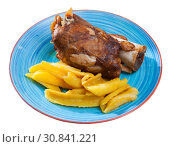 Купить «Close up of delicious baked pork knuckle with potatoes, served», фото № 30841221, снято 22 июля 2019 г. (c) Яков Филимонов / Фотобанк Лори