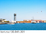 Port Vell in Barcelona with Maremagnum commercial center and cable car tower, Spain (2019 год). Редакционное фото, фотограф Papoyan Irina / Фотобанк Лори