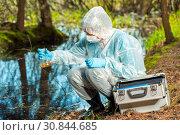 Купить «water sampling by an experienced ecologist from a forest river», фото № 30844685, снято 7 мая 2017 г. (c) Константин Лабунский / Фотобанк Лори