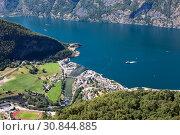 Купить «The Aurland town. Bird's eye view of Aurland from the Stegastein viewpoint in Norway, Scandinavia», фото № 30844885, снято 7 июля 2018 г. (c) Кекяляйнен Андрей / Фотобанк Лори