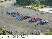 Купить «Pyongyang, North Korea. 1 May celebration», фото № 30845249, снято 1 мая 2019 г. (c) Знаменский Олег / Фотобанк Лори