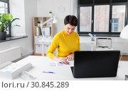 Купить «ui designer working on user interface at office», фото № 30845289, снято 23 февраля 2019 г. (c) Syda Productions / Фотобанк Лори