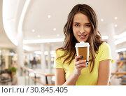 Купить «teenage girl drinking coffee in shopping mall», фото № 30845405, снято 29 января 2019 г. (c) Syda Productions / Фотобанк Лори