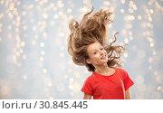 Купить «smiling teenage girl in red with long wavy hair», фото № 30845445, снято 17 февраля 2019 г. (c) Syda Productions / Фотобанк Лори