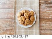 Купить «close up of oatmeal cookies on plate», фото № 30845497, снято 22 мая 2015 г. (c) Syda Productions / Фотобанк Лори