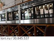 Купить «close up of wine bottles in dispenser at bar», фото № 30845537, снято 25 июня 2018 г. (c) Syda Productions / Фотобанк Лори