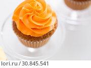 Купить «cupcake with frosting on confectionery stand», фото № 30845541, снято 6 июля 2018 г. (c) Syda Productions / Фотобанк Лори