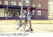 Купить «young man with fixed gear bicycle on crosswalk», фото № 30845621, снято 15 июня 2016 г. (c) Syda Productions / Фотобанк Лори