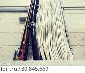 Купить «group of electricity cables at wall», фото № 30845669, снято 1 июля 2016 г. (c) Syda Productions / Фотобанк Лори