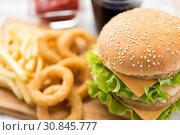 Купить «close up of hamburger and other fast food», фото № 30845777, снято 21 мая 2015 г. (c) Syda Productions / Фотобанк Лори