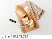 Купить «close up of white ciabatta bread on cutting board», фото № 30845789, снято 22 мая 2015 г. (c) Syda Productions / Фотобанк Лори
