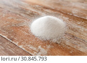 Купить «close up of white sugar heap on wooden table», фото № 30845793, снято 22 мая 2015 г. (c) Syda Productions / Фотобанк Лори