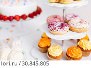 Купить «food and drinks on table at birthday party», фото № 30845805, снято 6 июля 2018 г. (c) Syda Productions / Фотобанк Лори