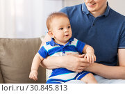 happy baby son with father at home. Стоковое фото, фотограф Syda Productions / Фотобанк Лори