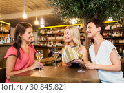 Купить «women giving present to friend at wine bar», фото № 30845821, снято 25 июня 2018 г. (c) Syda Productions / Фотобанк Лори